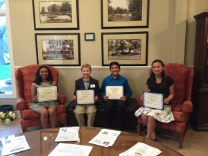 Winners of the Eighth Grade Essay Contest from left to right Mahima Srikanth, Luke Koski, Rohit Matal and Olivia Racette